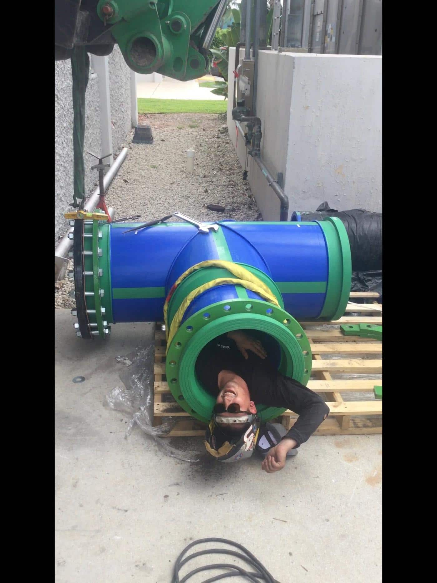 Installer in large diameter Aquatherm pipe.